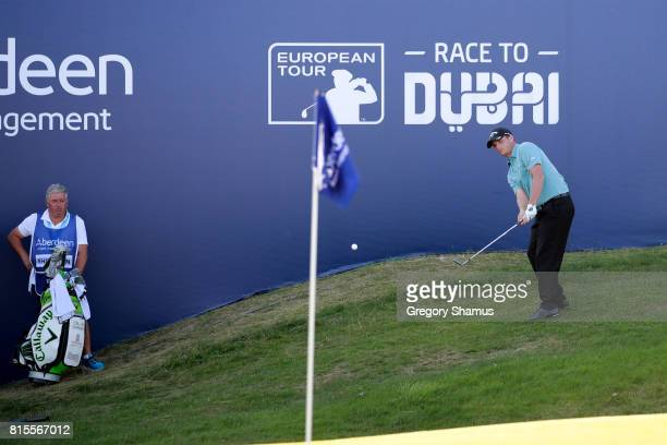 Callum Shinkwin of England chips to the 18th green during the final round of the AAM Scottish Open at Dundonald Links Golf Course on July 16 2017 in...