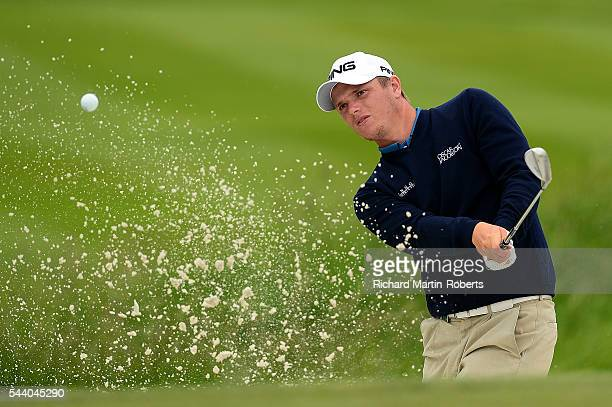 Callum Shinkwin of England hits from a bunker on the 10th hole during the second round of the 100th Open de France at Le Golf National on July 1 2016...
