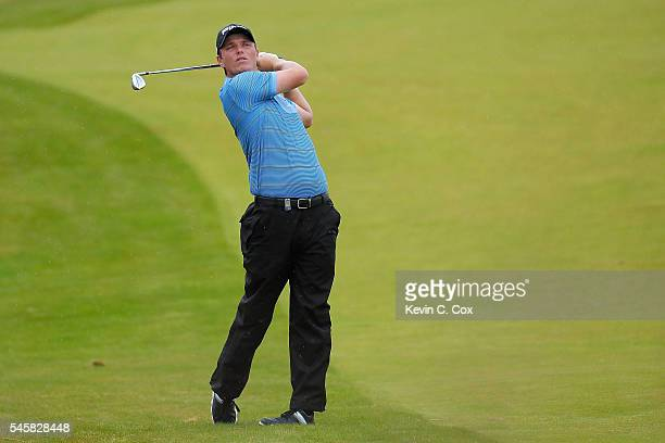 Callum Shinkwin of England hits his 2nd shot on the 5th hole during the final round of the AAM Scottish Open at Castle Stuart Golf Links on July 10...