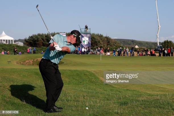 Callum Shinkwin of England hits his second shot on the 17th hole during the final round of the AAM Scottish Open at Dundonald Links Golf Course on...