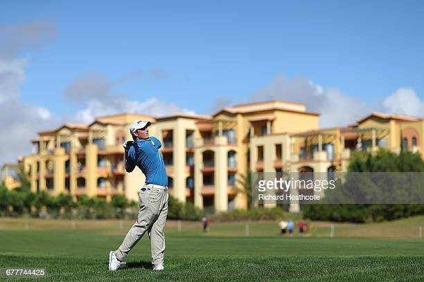 Callum Shinkwin of England hits his second shot on the 9th hole during day three of the Portugal Masters at Victoria Clube de Golfe on October 22...