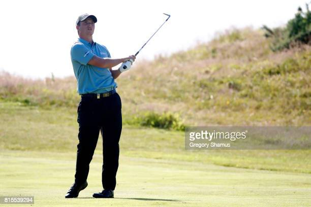 Callum Shinkwin of England hits his second shot on the 9th hole during the final round of the AAM Scottish Open at Dundonald Links Golf Course on...