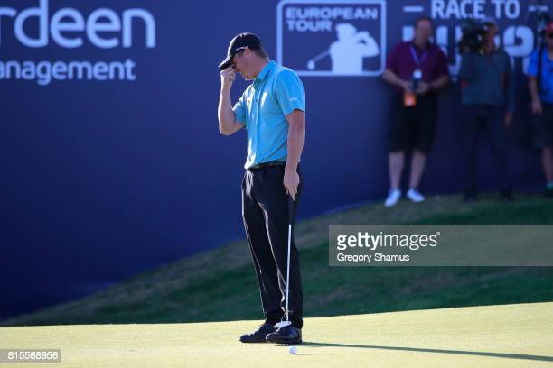 Callum Shinkwin of England reacts to a missed putt on the 18th green during the final round of the AAM Scottish Open at Dundonald Links Golf Course...