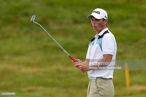 Callum Shinkwin of England reacts to a putt on his way to securing a place in the 2016 Open Championship at Royal Troon during the final round of the...