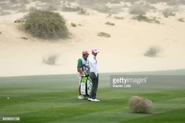 Callum Shinkwin of England reacts to a tumbleweed on the 9th hole during the second round of the Omega Dubai Desert Classic at Emirates Golf Club on...