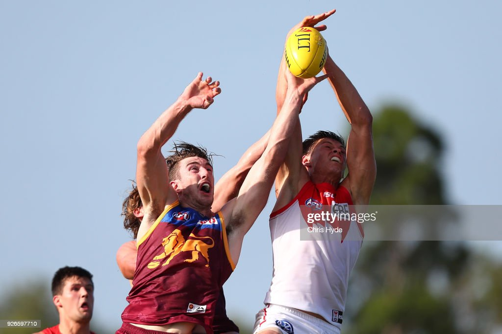 Callum Sinclair of th Swans takes a mark over Daniel McStay of the Lions during the AFL JLT Community Series match between the Brisbane Lions and the Sydney Swans at Moreton Bay Central Sports Complex on March 3, 2018 in Brisbane, Australia.