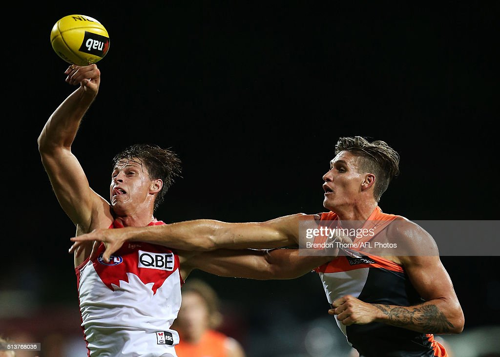 Callum Sinclair of the Swans competes with Rory Lobb of the Giants during the 2016 AFL NAB Challenge match between the Sydney Swans and the Greater Western Sydney Giants at Drummoyne Oval on March 4, 2016 in Sydney, Australia.