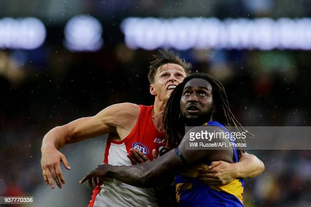 Callum Sinclair of the Swans contests a ruck with Nic Naitanui of the Eagles during the round one AFL match between the West Coast Eagles and the...