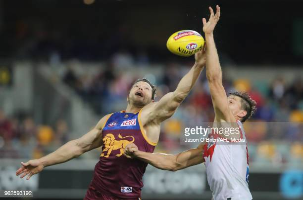 Callum Sinclair of the Swans in action with Stefan Martin of the Lions during the round 10 AFL match between the Brisbane Lions and the Sydney Swans...