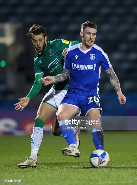 Callum Slattery of Gillingham FC battles for possession with Jorge Grant of Lincoln City during the Sky Bet League One match between Gillingham and...