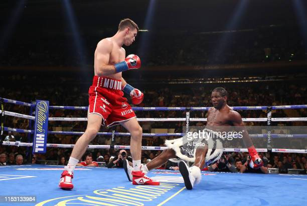 Callum Smith knocks down Hassan N'Dam during the first round of their WBA super middleweight title fight at Madison Square Garden on June 01 2019 in...