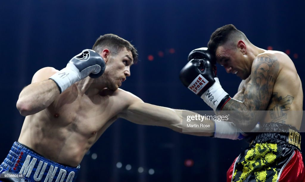 Callum Smith L Of England Exchange Punches With Nieky Holzken Of Netherlands During The