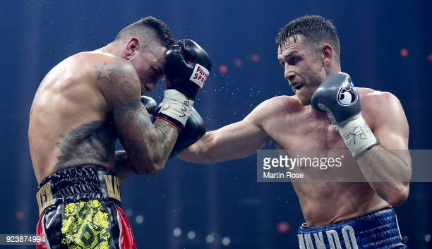 Callum Smith of England exchange punches with Nieky Holzken of Netherlands during the Ali Trophy Super Middleweight SemiFinal fight at Arena...