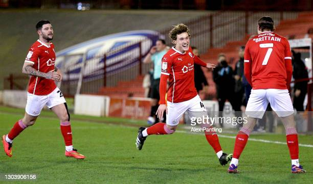 Callum Styles of Barnsley celebrates with Alex Mowatt and Callum Brittain after scoring their team's first goal during the Sky Bet Championship match...