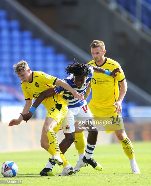 Callum Styles of Barnsley is tackled by Ovie Ejaria of Reading during the Sky Bet Championship match between Reading and Barnsley at Madejski Stadium...