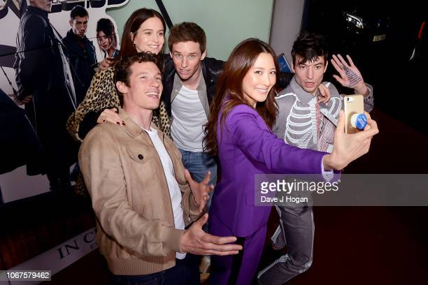 Callum Turner Katherine Waterston Eddie Redmayne Claudia Kim and Ezra Miller surprise fans at a screening of 'Fantastic Beasts The Crimes Of...