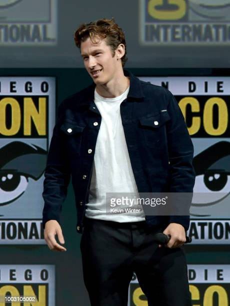 Callum Turner speaks onstage at the Warner Bros theatrical panel during ComicCon International 2018 at San Diego Convention Center on July 21 2018 in...