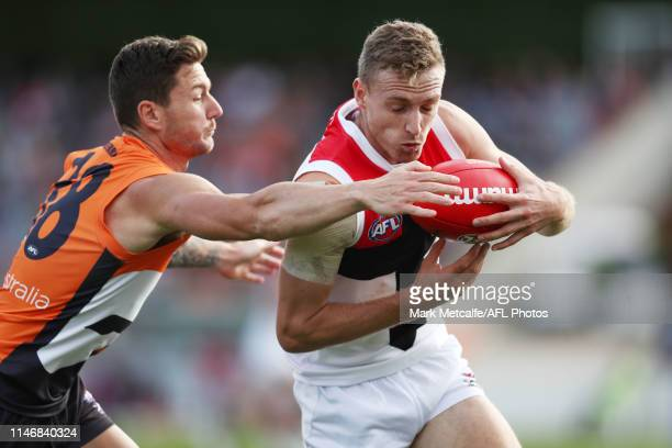 Callum Wilkie of the Saints is tackled by Daniel Lloyd of the Giants during the round seven AFL match between the Greater Western Sydney Giants and...