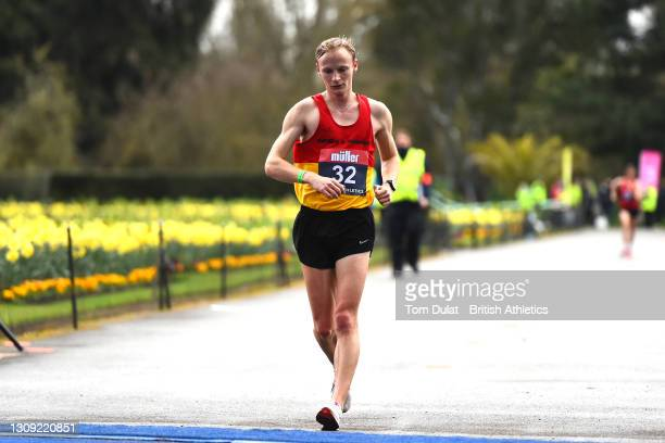Callum Wilkinson crosses the line first as he wins the mens 20km walking race during the Muller British Athletics Marathon and 20km Walk Trials at...