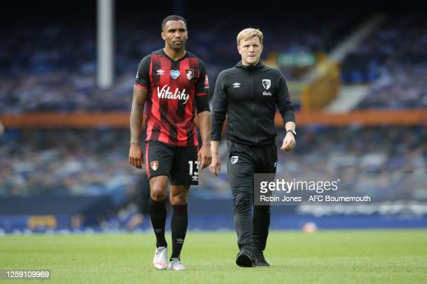 Callum Wilson and Eddie Howe of Bournemouth leave the pitch after their side are relegated after the Premier League match between Everton FC and AFC...