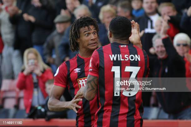 Callum Wilson congratulates teammate Nathan Ake of Bournemouth after he scores a goal to make it 10 during the Premier League match between AFC...