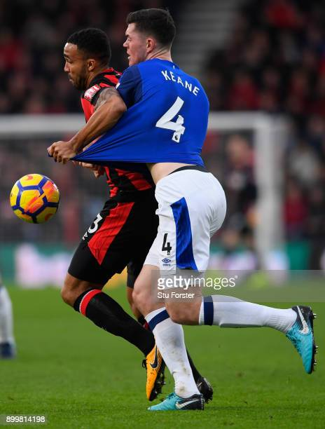 Callum Wilson of AFC Bournemouth and Michael Keane of Everton battle for possession during the Premier League match between AFC Bournemouth and...