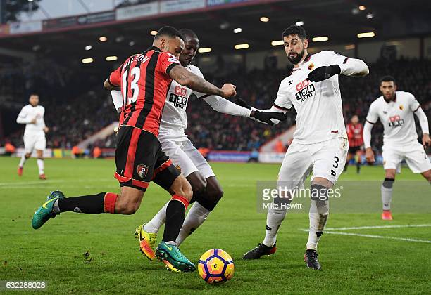 Callum Wilson of AFC Bournemouth attempts to get past Abdoulaye Doucoure of Watford and Miguel Britos of Watford during the Premier League match...