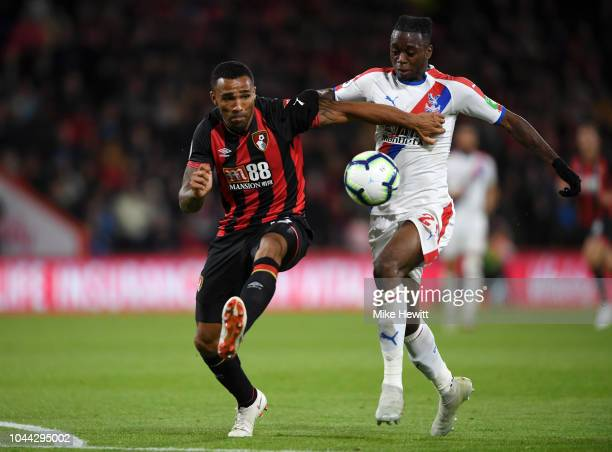 Callum Wilson of AFC Bournemouth battles for possession with Aaron WanBissaka of Crystal Palace during the Premier League match between AFC...