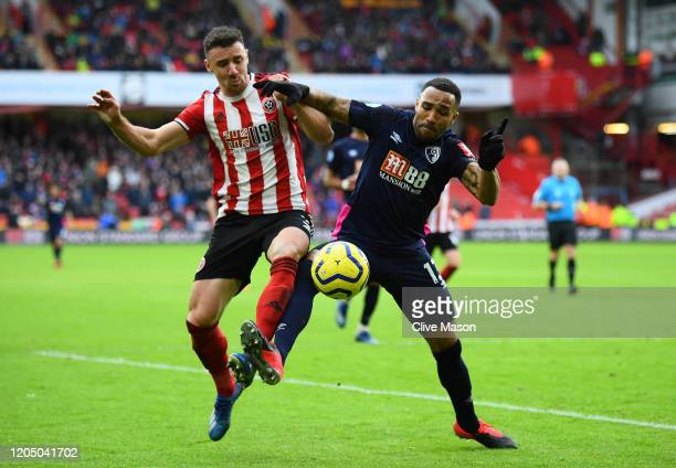 Callum Wilson of AFC Bournemouth battles for possession with Enda Stevens of Sheffield United during the Premier League match between Sheffield...