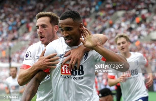 Callum Wilson of AFC Bournemouth celebrates after scoring his team's first goal with team mate Dan Gosling during the Premier League match between...