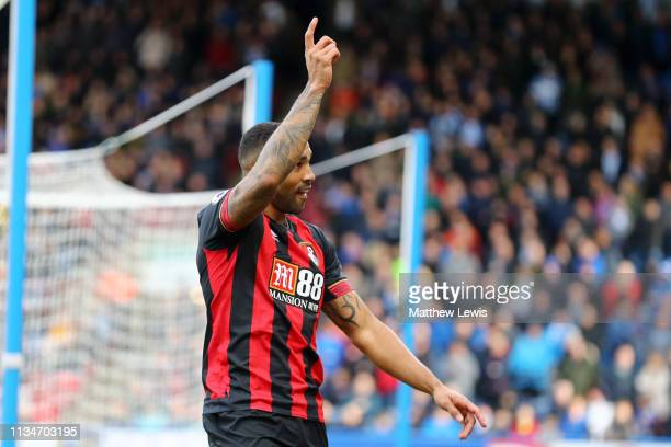 Callum Wilson of AFC Bournemouth celebrates after scoring his team's first goal during the Premier League match between Huddersfield Town and AFC...