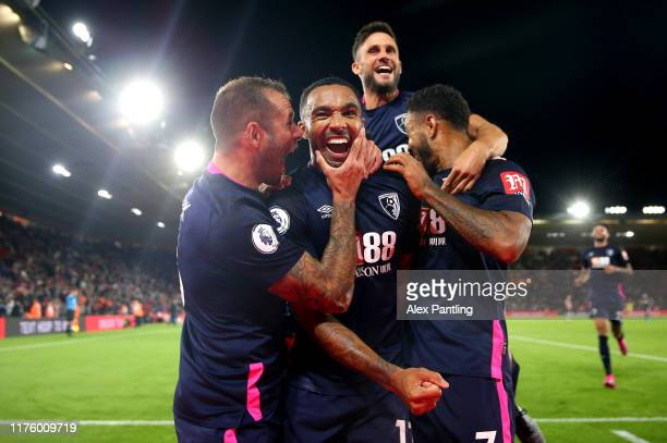 Callum Wilson of AFC Bournemouth celebrates after scoring his team's third goal with Steve Cook and Joshua King of AFC Bournemouth during the Premier...