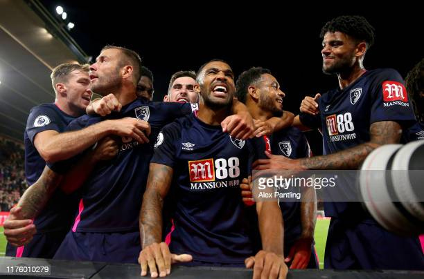 Callum Wilson of AFC Bournemouth celebrates after scoring his team's third goal with his team mates during the Premier League match between...