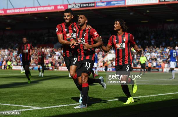 Callum Wilson of AFC Bournemouth celebrates as he scores his team's first goal with Dominic Solanke and Nathan Ake during the Premier League match...