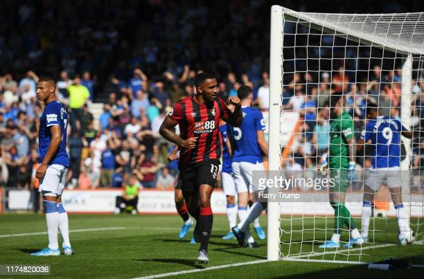 Callum Wilson of AFC Bournemouth celebrates as he scores his team's first goal as Everton players react during the Premier League match between AFC...