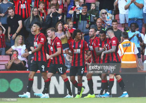 Callum Wilson of AFC Bournemouth celebrates as he scores his team's third goal with team mates during the Premier League match between AFC...