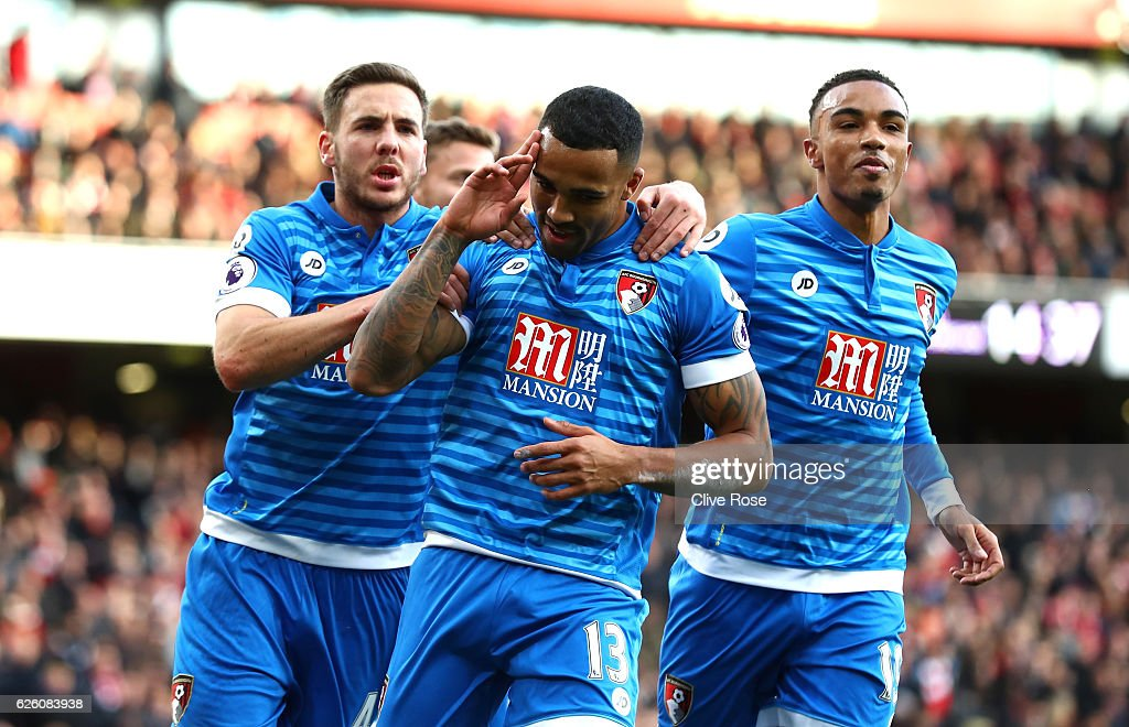 Callum Wilson of AFC Bournemouth (C) celebrates scoring his sides first goal with Dan Gosling of AFC Bournemouth (L) and Junior Stanislas of AFC Bournemouth (R) during the Premier League match between Arsenal and AFC Bournemouth at Emirates Stadium on November 27, 2016 in London, England.