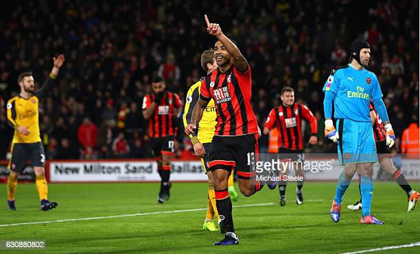 Callum Wilson of AFC Bournemouth celebrates scoring his side's second goal from the penalty spot during the Premier League match between AFC...