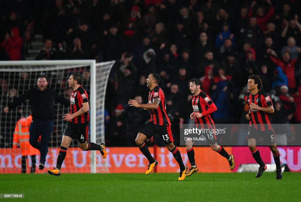 Callum Wilson of AFC Bournemouth (c) celebrates with his team mates after scoring his sides third goal during the Premier League match between AFC Bournemouth and West Ham United at Vitality Stadium on December 26, 2017 in Bournemouth, England.