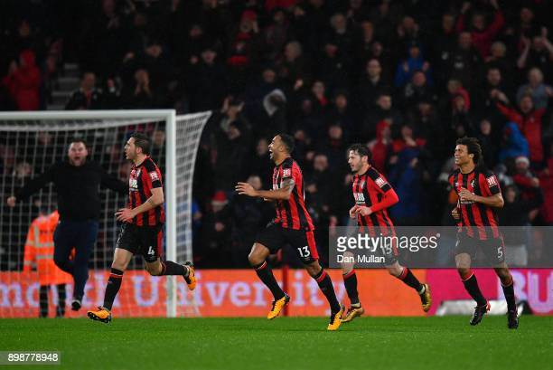 Callum Wilson of AFC Bournemouth celebrates with his team mates after scoring his sides third goal during the Premier League match between AFC...