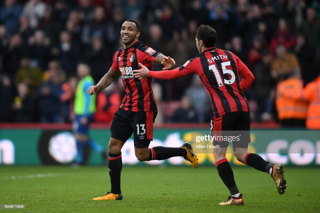 Callum Wilson of AFC Bournemouth celebrates with team mate Adam Smith after scoring the first AFC Bournemouth goal during the Premier League match between AFC Bournemouth and Arsenal at Vitality Stadium on January 14, 2018 in Bournemouth, England.