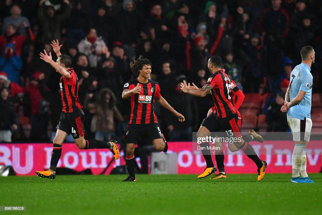 Callum Wilson of AFC Bournemouth celebrates with team mates Nathan Ake and Dan Gosling after scoring their sides third goal during the Premier League match between AFC Bournemouth and West Ham United at Vitality Stadium on December 26, 2017 in Bournemouth, England.