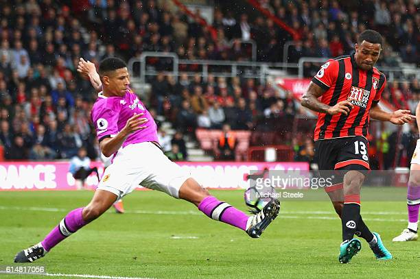 Callum Wilson of AFC Bournemouth has his shot deflected on to the bar by Curtis Davies of Hull City during the Premier League match between AFC...