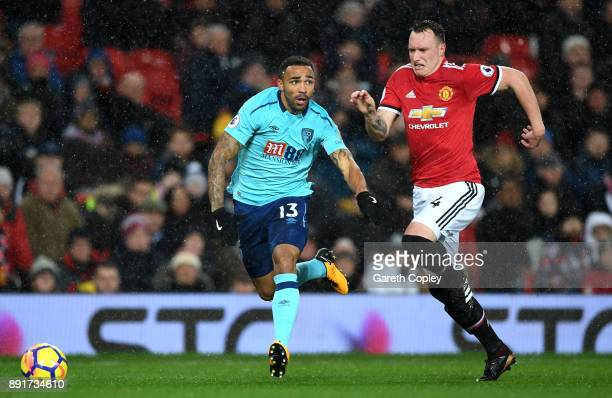Callum Wilson of AFC Bournemouth is challenged by Phil Jones of Manchester United during the Premier League match between Manchester United and AFC...