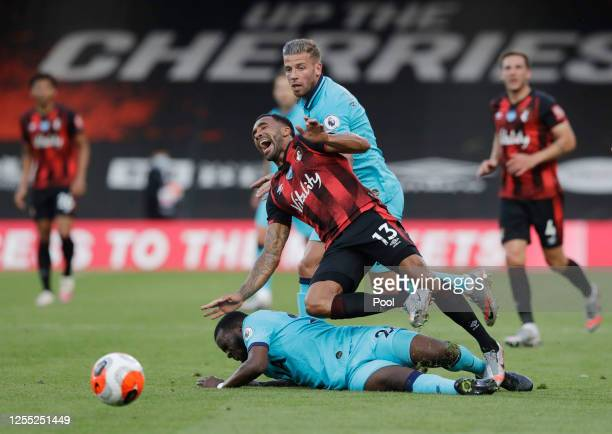 Callum Wilson of AFC Bournemouth is challenged by Tanguy Ndombele of Tottenham Hotspur during the Premier League match between AFC Bournemouth and...