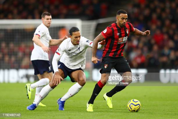 Callum Wilson of AFC Bournemouth is challenged by Virgil van Dijk of Liverpool during the Premier League match between AFC Bournemouth and Liverpool...
