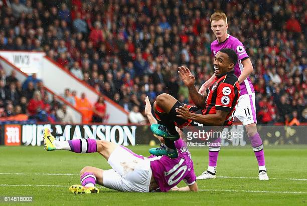 Callum Wilson of AFC Bournemouth is fouled by Robert Snodgrass of Hull City for a penalty to be awarded to AFC Bournemouth during the Premier League...