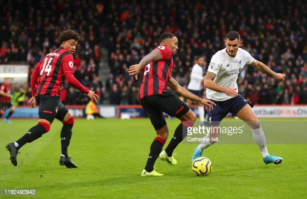 Callum Wilson of AFC Bournemouth is put under pressure by Dejan Lovren of Liverpool during the Premier League match between AFC Bournemouth and...