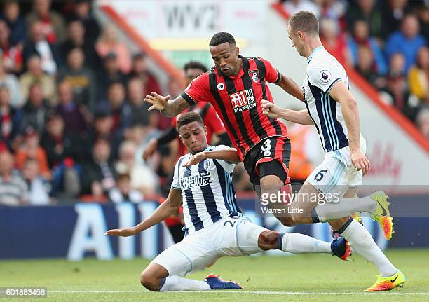 Callum Wilson of AFC Bournemouth is taken down by Brendan Galloway of West Bromwich Albion during the Premier League match between AFC Bournemouth...