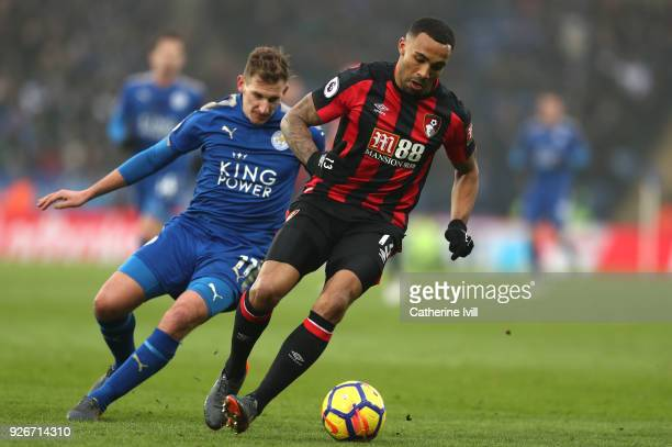 Callum Wilson of AFC Bournemouth runs with the ball away from Marc Albrighton of Leicester City during the Premier League match between Leicester...